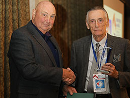Neil Young accepting the Sports Hall Inductee award from Committee Chair, Bob McGeein
