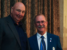 Dave Shewfelt accepting the Sports Hall Inductee award from Committee Chair, Bob McGeein