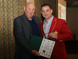 Aaron Carpenter accepting the Sports Hall Inductee award from Committee Chair, Bob McGeein